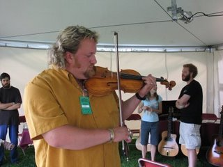J.P. Cormier trying a violin